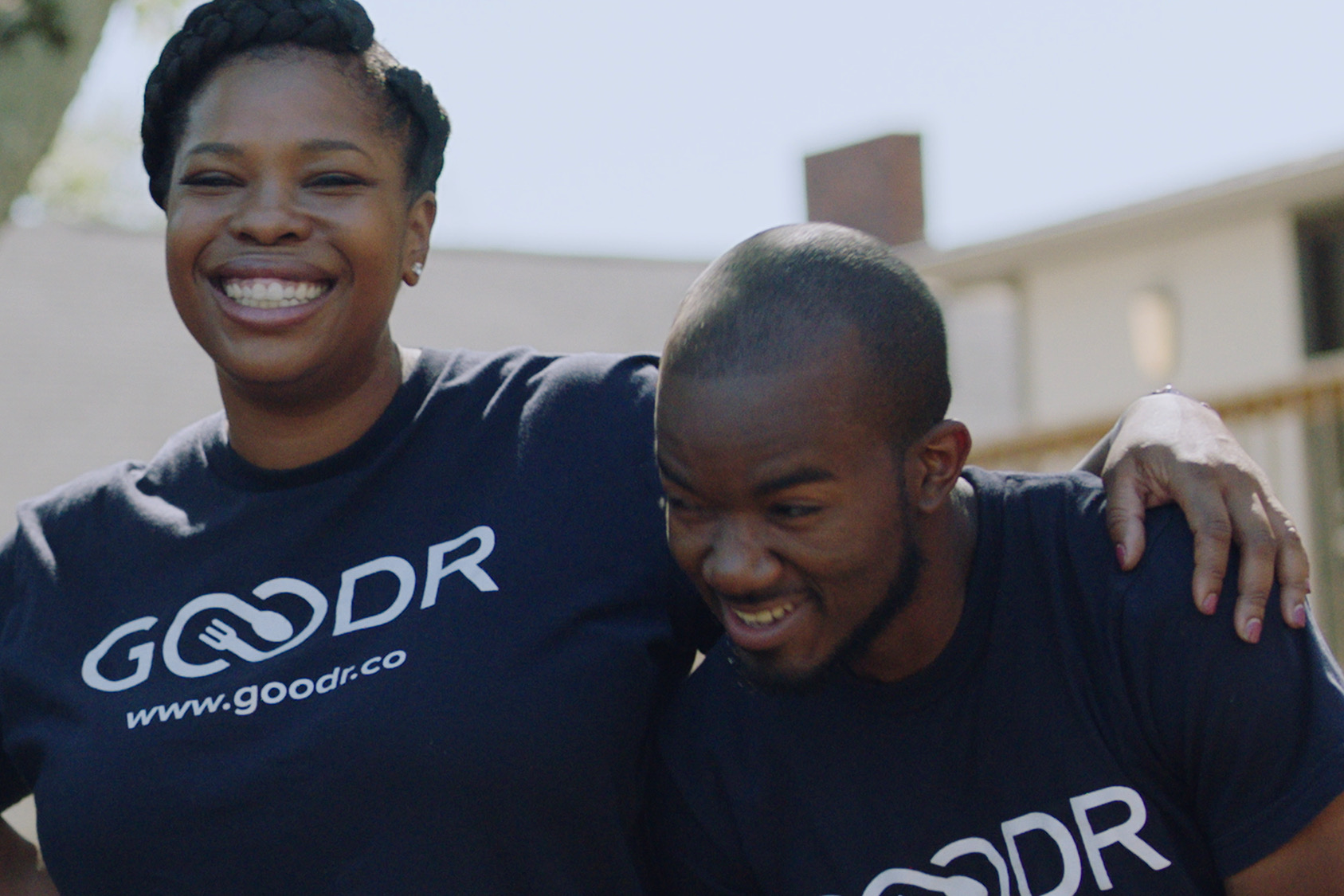 a woman and a man from Goodr smiling